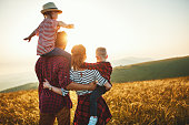 istock Happy family: mother, father, children son and daughter on sunset 1180847640