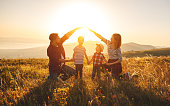 istock Happy family: mother, father, children son and daughter on sunset 996495946