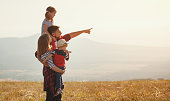 istock Happy family: mother, father, children son and daughter on sunset 997291558