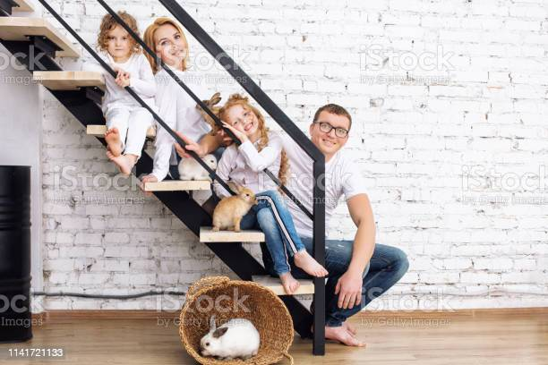 Happy family mother father two daughters and furry animal rabbits at picture id1141721133?b=1&k=6&m=1141721133&s=612x612&h=qqk4nbegkyfrrpa n4eqdcc17iz4zdrqlpyx0clx9rg=