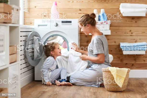 Happy family mother housewife and child in laundry with washing picture id842785478?b=1&k=6&m=842785478&s=612x612&h=lxwwk4 e2lyc7jxocwsy9bdw5g7koissubhg9cnjfm8=