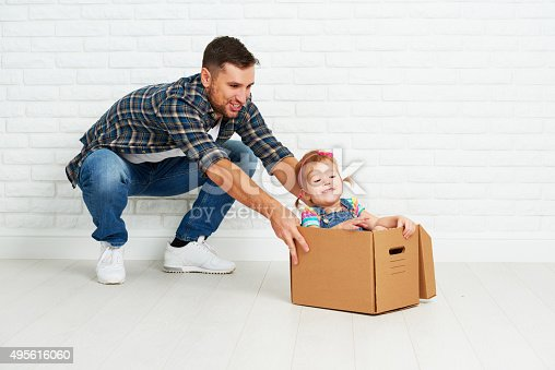 496487362 istock photo happy family moves to new apartment. 495616060