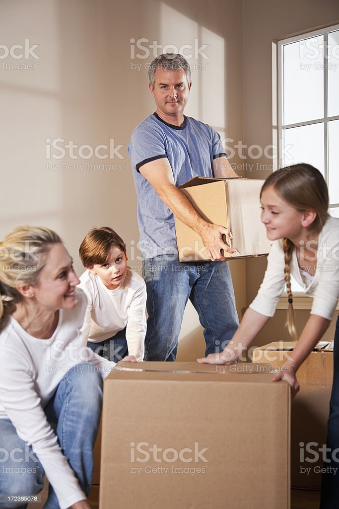 Happy family moving into new home stock photo