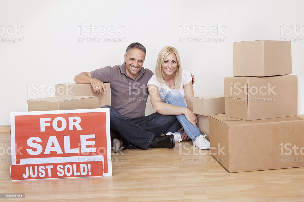 Happy family moving into the new home royalty-free stock photo