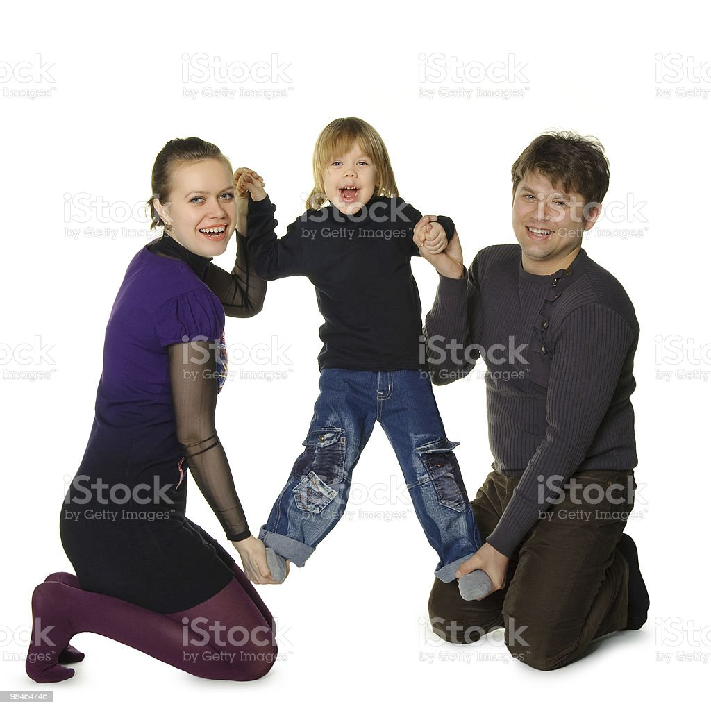 Happy family. Mum and the daddy hold son in hands royalty-free stock photo