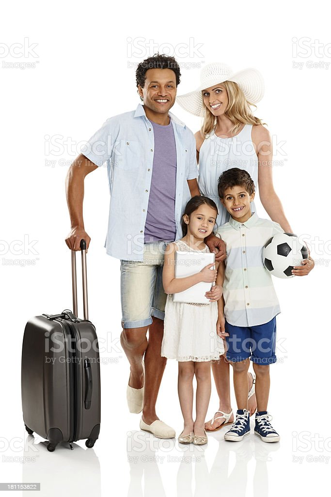 Happy family of four going on summer holiday royalty-free stock photo