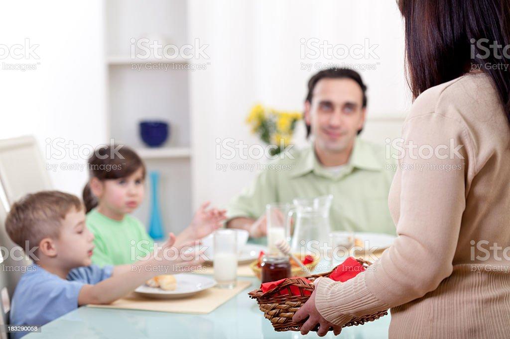 Happy family of four having breakfast royalty-free stock photo