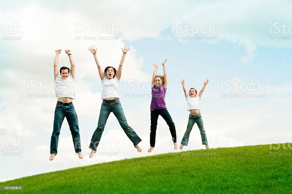 Happy family of four jumping on earth, full length. royalty-free stock photo