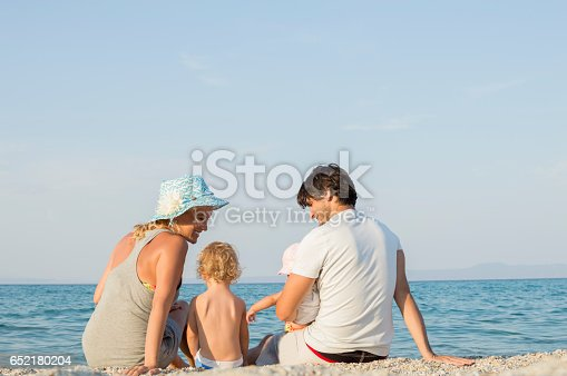 istock Happy family of four on beach vacation 652180204