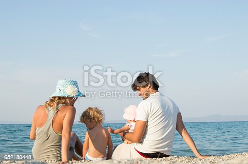 istock Happy family of four on beach vacation 652180448