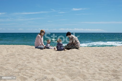 istock Happy family of four on beach vacation 686989714