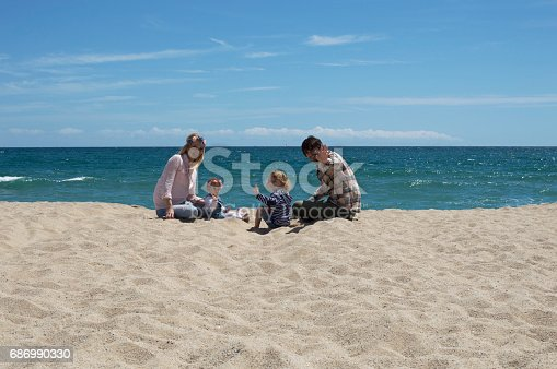 istock Happy family of four on beach vacation 686990330