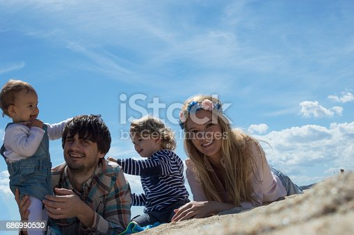 istock Happy family of four on beach vacation 686990530