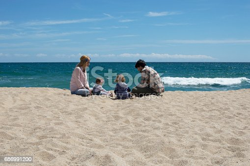 istock Happy family of four on beach vacation 686991200