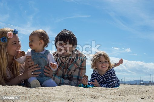istock Happy family of four on beach vacation 686995282