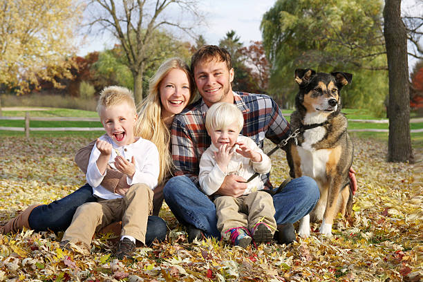 Happy Family of Four People and Dog OUtside in Autumn stock photo
