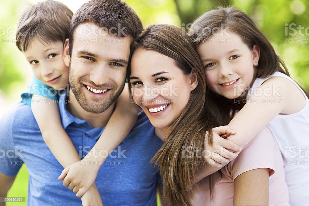 Happy family of four stock photo