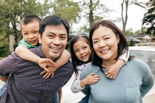 897806552 istock photo Happy family of four 691559048