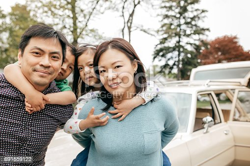 897806552istockphoto Happy family of four 691559122