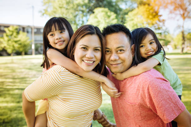 Happy family of four Two parents and two kids immigrant stock pictures, royalty-free photos & images