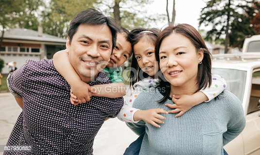 897806552istockphoto Happy family of four 807950882