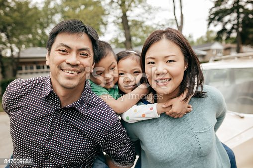 897806552istockphoto Happy family of four 847009684
