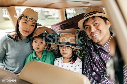 897806552istockphoto Happy family of four 847009696