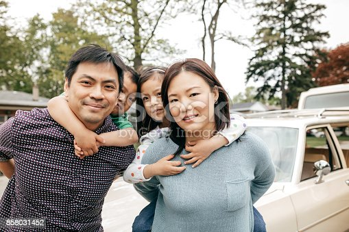 897806552istockphoto Happy family of four 858031452