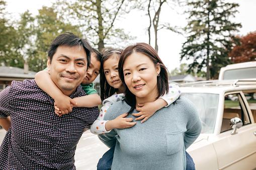 897806552 istock photo Happy family of four 858031452