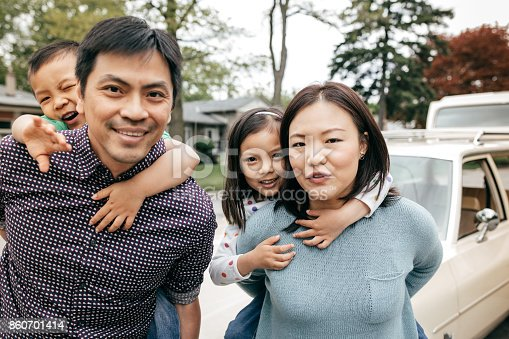 897806552istockphoto Happy family of four 860701414