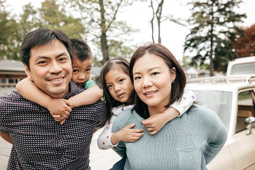 897806552 istock photo Happy family of four 866792490