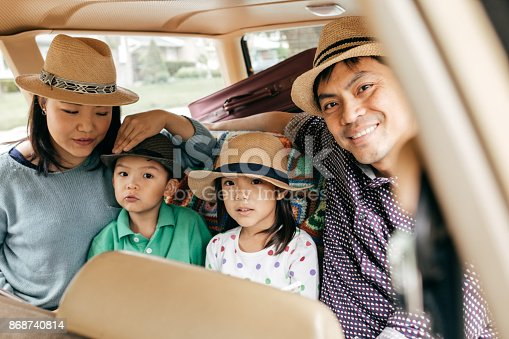 897806552istockphoto Happy family of four 868740814