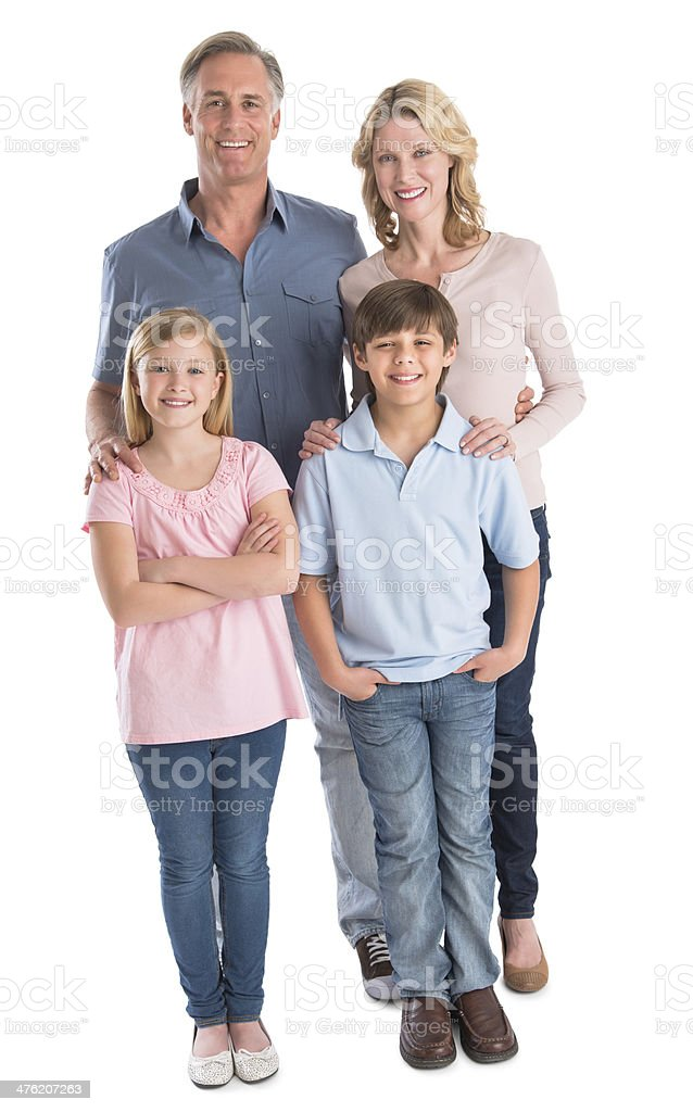Happy Family Of Four Smiling Against White Background stock photo