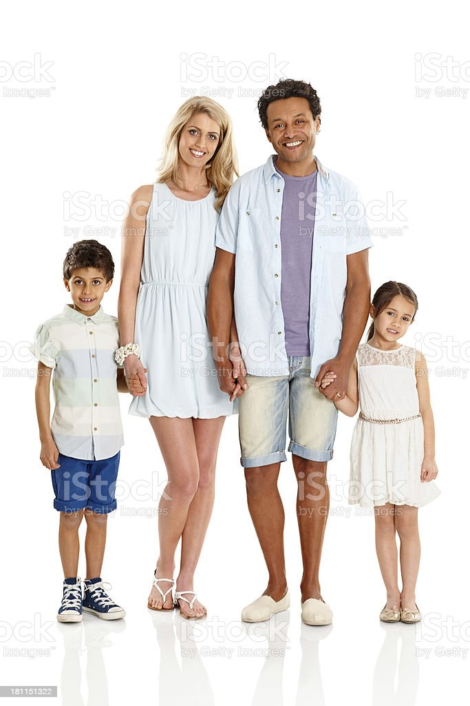 Happy family of four wearing summer wear standing together royalty-free stock photo