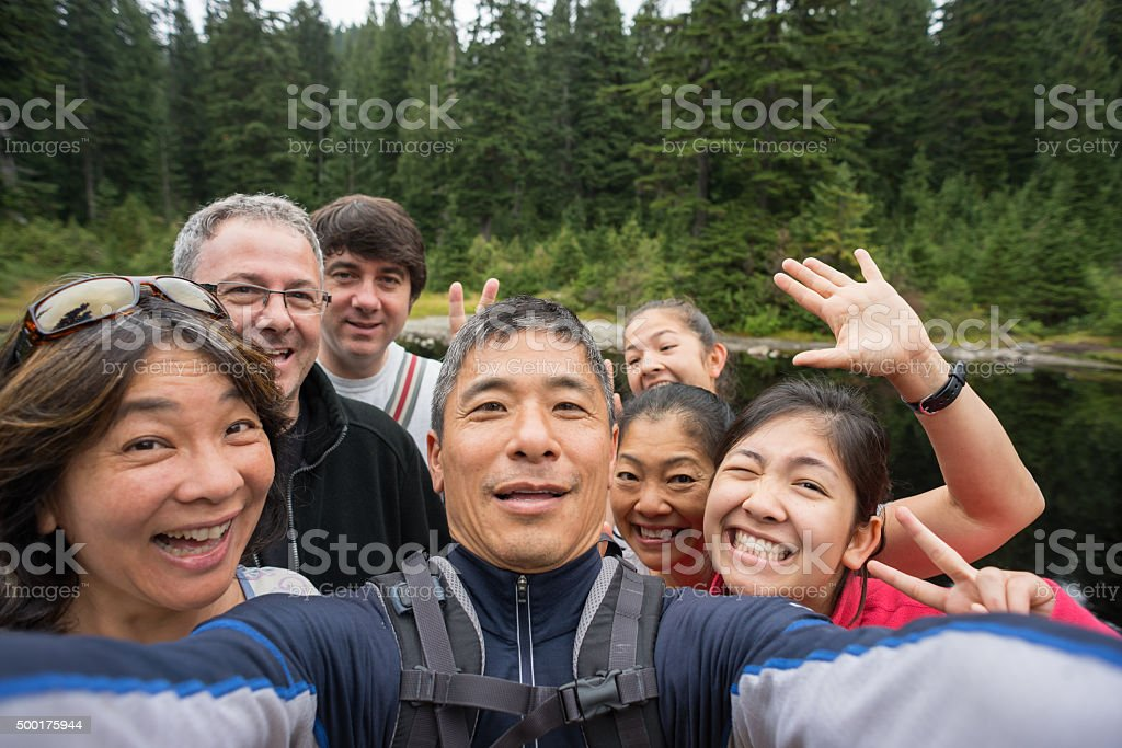 Happy Family of Hikers Making Faces While Taking Selfie, Canada stock photo