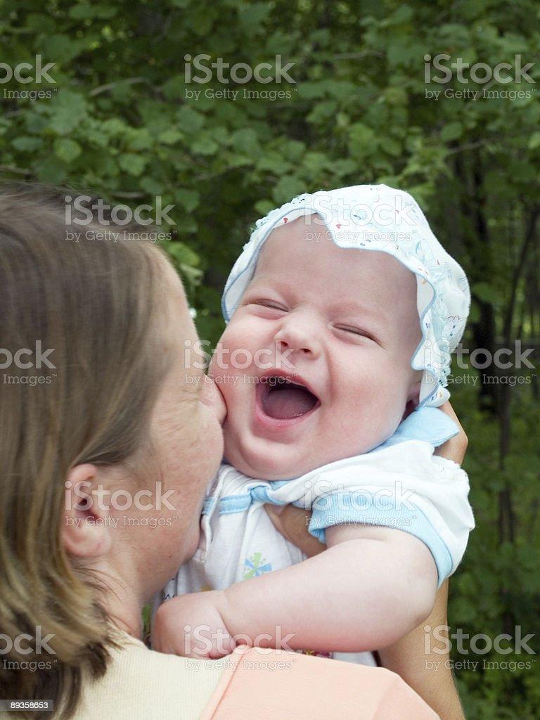 happy family of mother and baby in the park royaltyfri bildbanksbilder