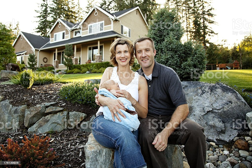 Happy family of three at home Mother Father newborn royalty-free stock photo