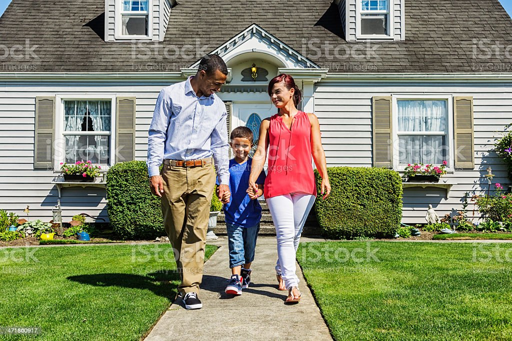 Happy Family of Three Going for a Walk stock photo