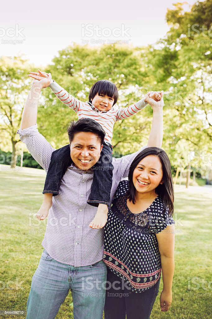 Happy family of three stock photo