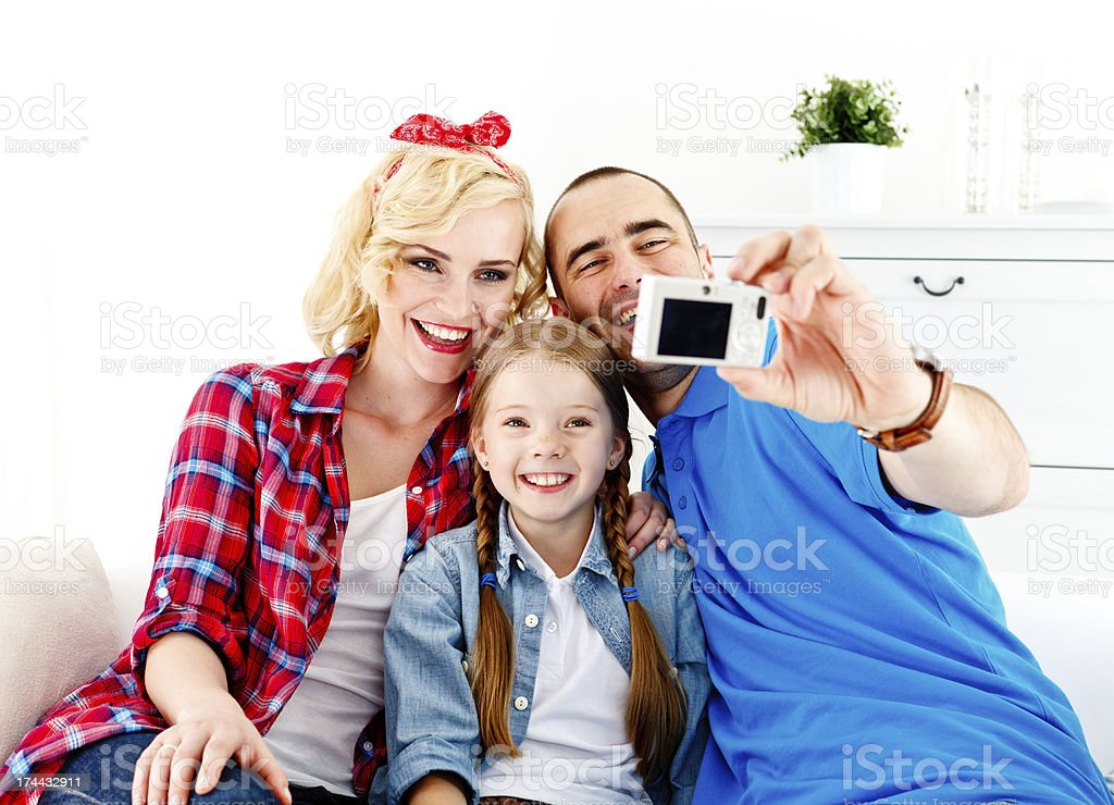 Happy Family of Three Taking Self Portrait royalty-free stock photo