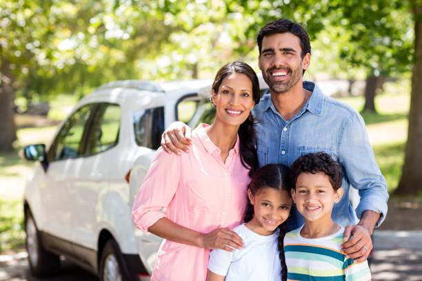 Happy family on a picnic standing next to their car Portrait of happy family on a picnic standing next to their car 30 39 years stock pictures, royalty-free photos & images