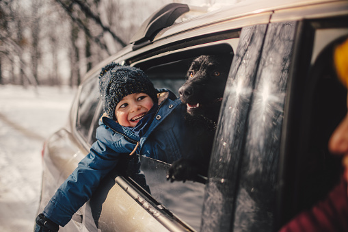 Happy family on a winter road trip