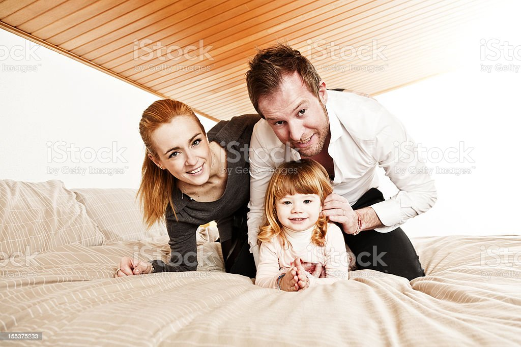 Happy Family on bed royalty-free stock photo