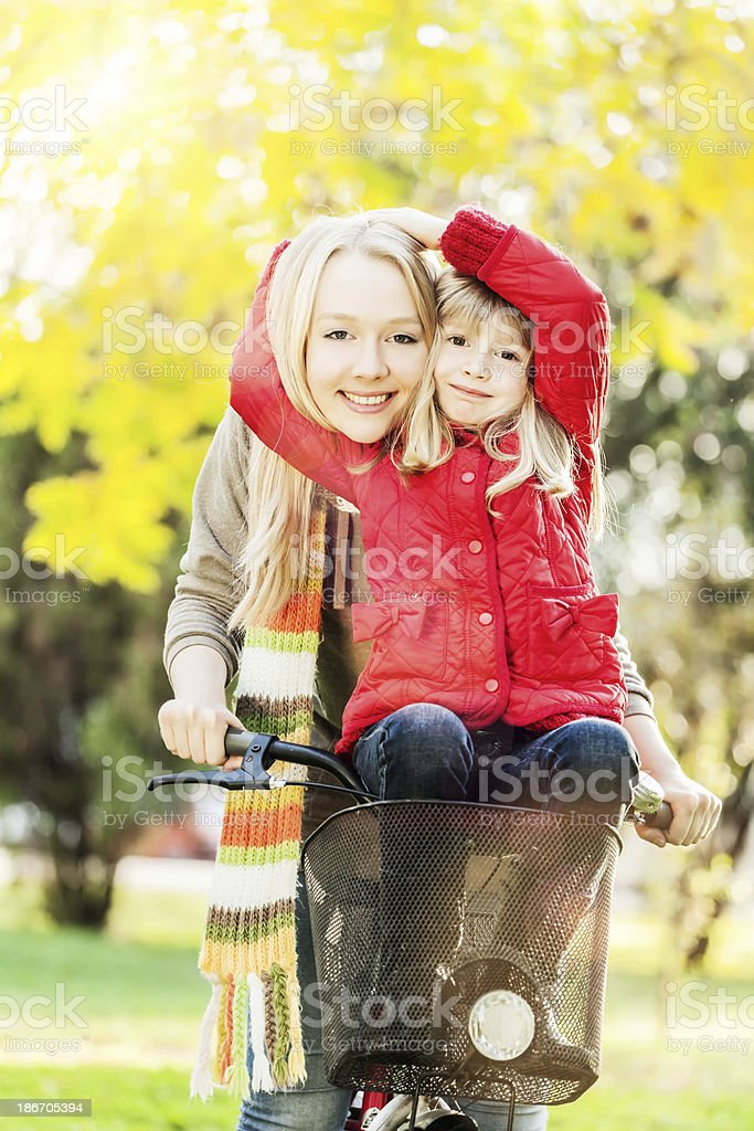 Happy family on bikes cycling outdoors in autumn forest royalty-free stock photo