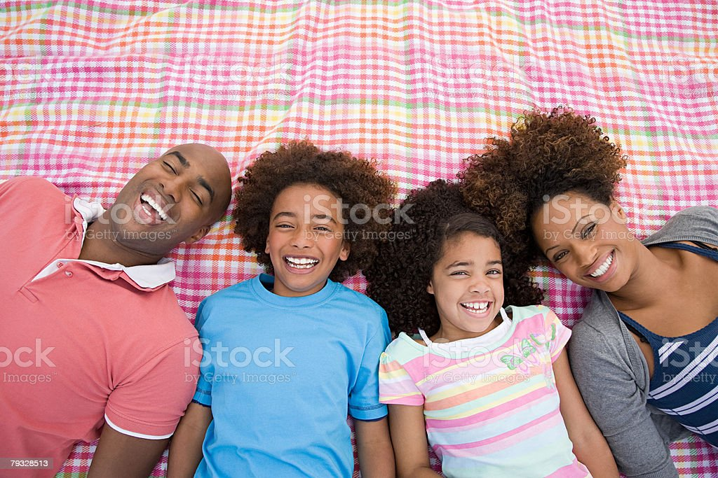 Happy family on blanket 免版稅 stock photo