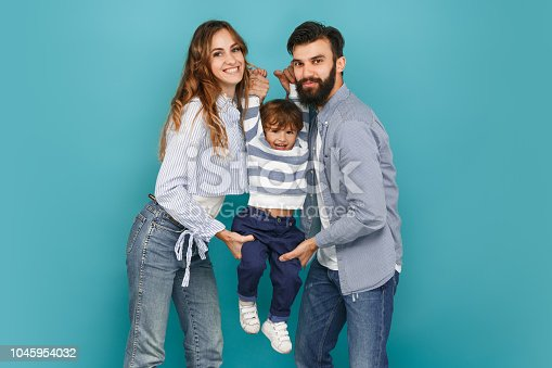 istock A happy family on blue background 1045954032