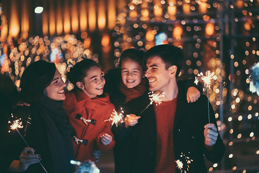 Young family with two kids celebrating New Year