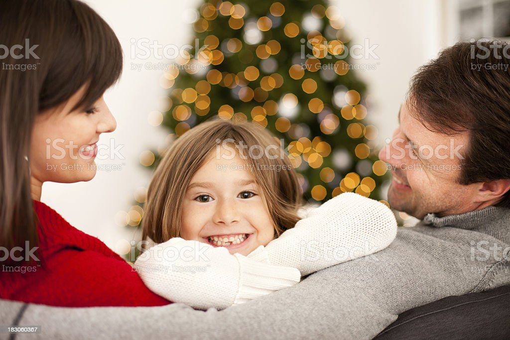 Happy Family on Couch at Home with Christmas Tree royalty-free stock photo