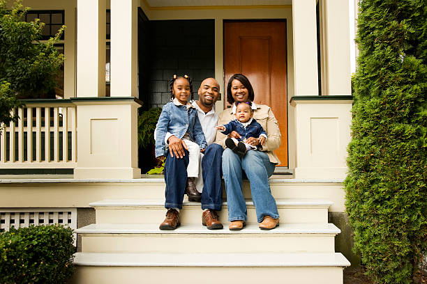 Happy Family on Front Porch stock photo