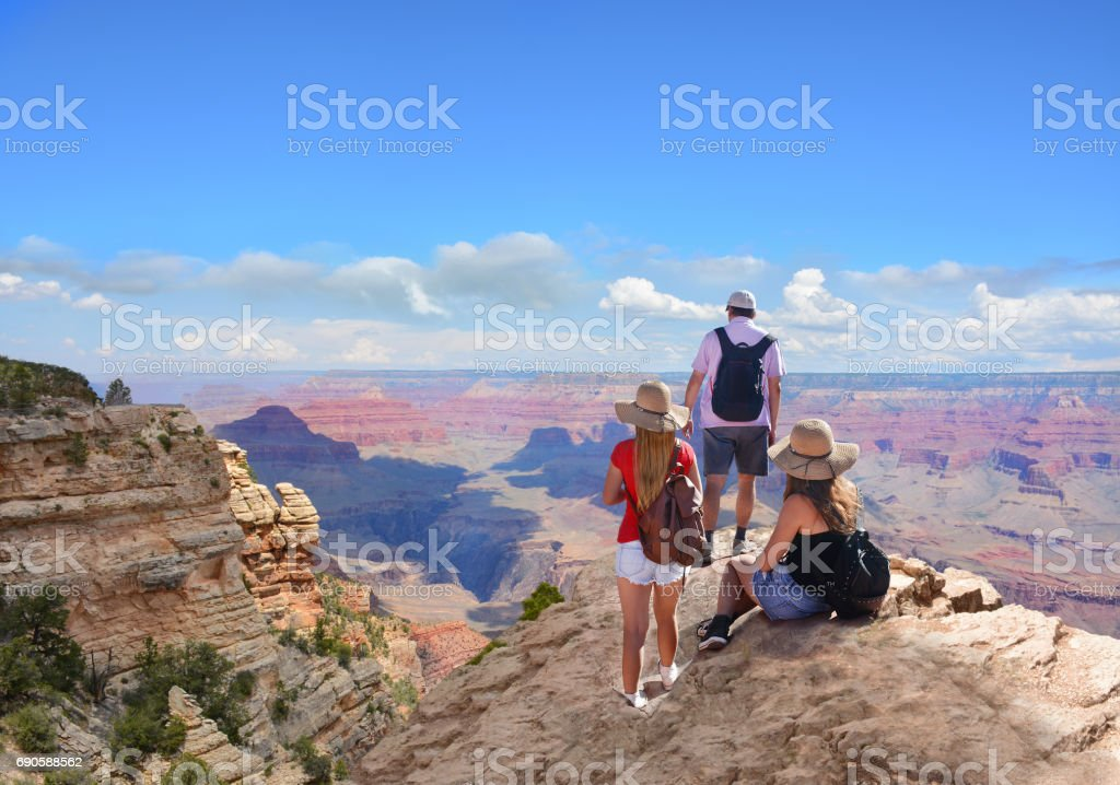 Happy family on hiking trip in beautiful mountains. stock photo